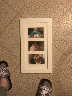 White frame, holds three pictures