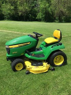 John Deere tractors, carts, decks,wheel weights, etc.