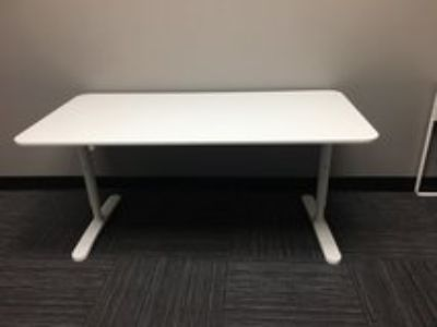 2 adjustable white tables