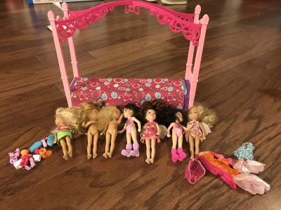 Barbie bed with dolls