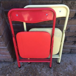 Two child sized fold up chairs