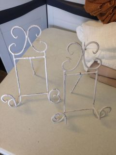 2 plate or picture metal holders.