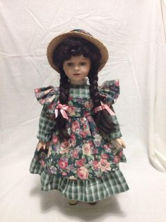 """Homco Porcelain Doll. 17"""" tall with metal stand. Pick up at Target in McCalla on Thursdays 5:15 to 6:00pm."""