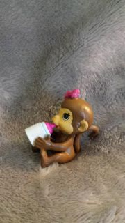 Mintature monkey thst holds his own bottle see other phoo.