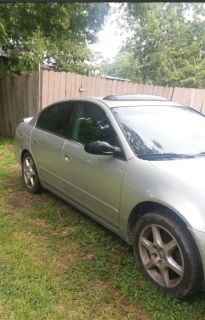 2003 Nissan Altima It's runs but the motor makes noises. I bought it this way I just haven't had time to fix it. It does have a title
