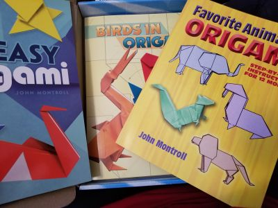 3 origami books and unopened paper plane kit
