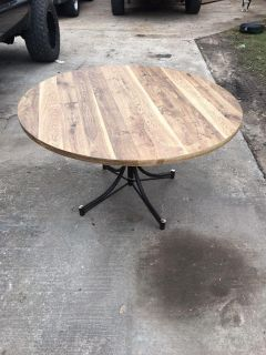 Nice large round dining table with laminate wood grain finish top