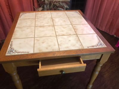Solid wood dinning table 36 x36 30 yrs old from N. Carolina, excellent condition tile top 4 chair.