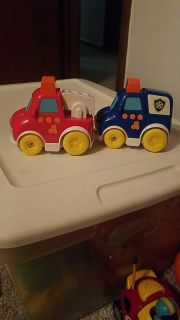 Two very cute musical sound push toys cars trucks fire truck and police car