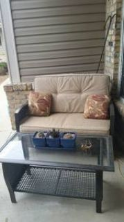 Patio loveseat and glass table