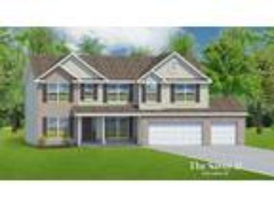 The Savoy II - 3 Car Garage by T.R. Hughes Homes: Plan to be Built