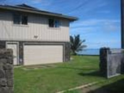 Kualoa Beach Ocean Front 4/3 House with Large Yard and Gated Entry.
