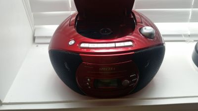 Red boom box with cd player