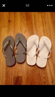 2 pairs of silver and white old navy flip flops