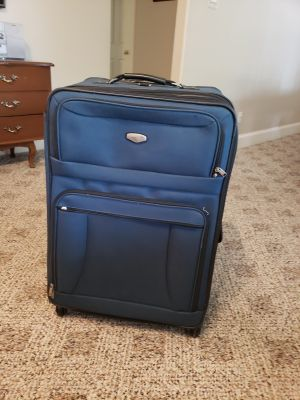 Big luggage great condition just the wheel first layer is off but still rolls. See pic