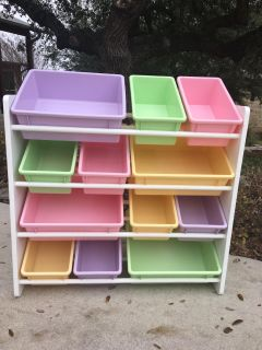 Shelf storage with removable tubs. Approximately 37 tall x34 wide