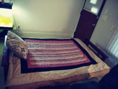 FUTON COUCH AND A BED IN ONE
