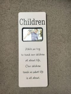 Cute picture frame. Measures 8x21. Holds a 4x6 picture