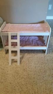 Adorable little wooden bunk beds. Perfect size for American Girl Dolls. Excellent condition. Comes with bedding as well.