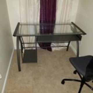 Metal computer desk with glass top