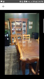 Table with 6 chairs and China cabinet