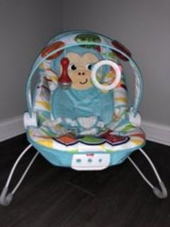 Fisher Price Deluxe Kick N Play Musical Bouncer