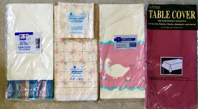 FOUR VINTAGE ASSORTED PARTY TABLE COVERS, NEW IN PKG.