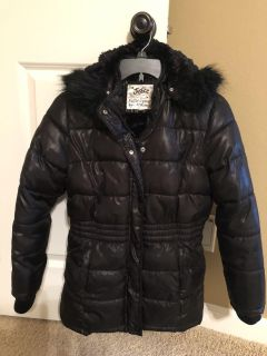 Justice brand warm winter coat. Fuzzy inner lining with side pockets and removable fur hood. Coat is in excellent condition.