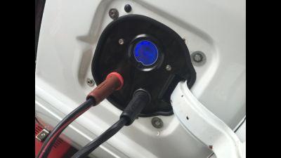 fuel door charging panel