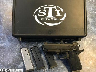 For Sale: STI SPARTAN III 1911 with CTC LASER GRIPS, 4 mags and case!