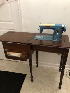 Sewing machine with antique table