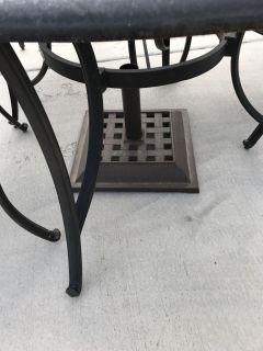 Patio table, 4 chairs with umbrella stand