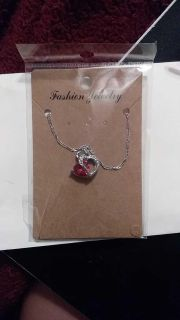 Brand new in package!!! Garnet or red stone heart necklace