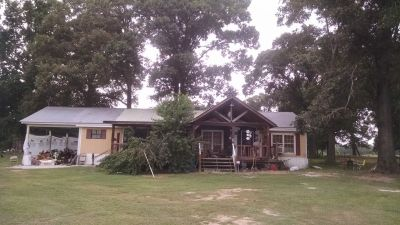 3 bedroom and 2 bath double wide with a metal roof build over it has carport n porches on front ...