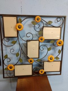 Metal wall hanging with sunflowers