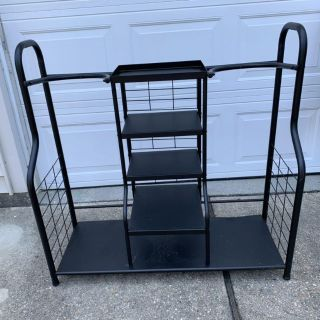 LARGE METAL GOLF RACKS THAT HOLDS 2 SETS CLUBS