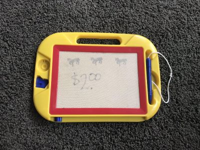 Write and learn/doodle with horse stamp. Push blue button on bottom to the right to erase. 12 Length X 9 Height
