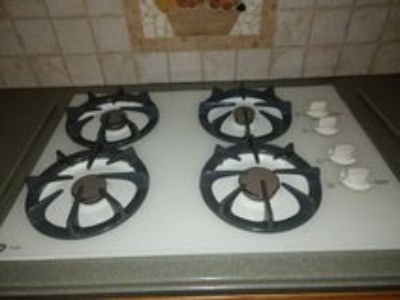 GE gas stove top and GE microwave