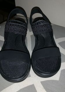 Practically new - and very cute Skechers sling back wedge sandals