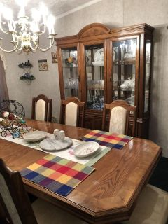 Solid oak dining room suite. China hutch, table and 8 chairs