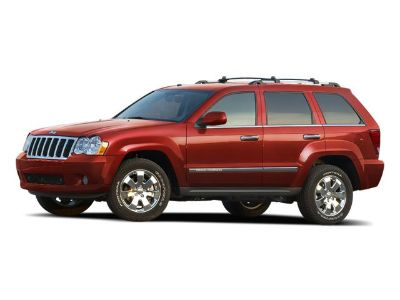 2010 Jeep Grand Cherokee Laredo (Inferno Red Crystal Pearl)