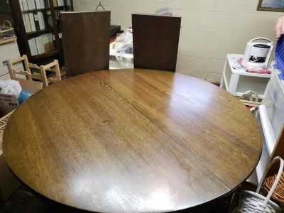 Solid wood dining table with 2 leaves. 4 unfinished chairs included