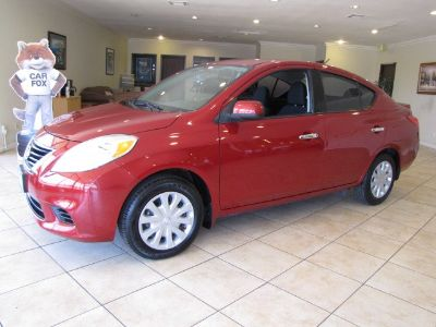 2013 Nissan Versa 1.6 S (Red Brick Metallic)