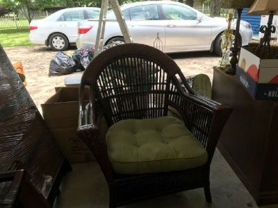 Pier I Imports brown wicker chair and ottoman with cushions