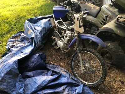 Four wheeler and dirt bike for sale.