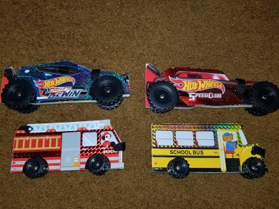 Set of 4 NEW vehicle books with rolling wheels