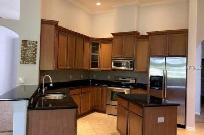 "The kitchen has 42"" WOOD CABINETS and a LARGE BREAKFAST BAR!"