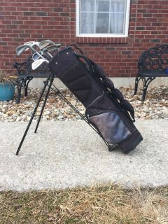 old, juniors set golf bag and clubs. hodgepodge of clubs. $8!