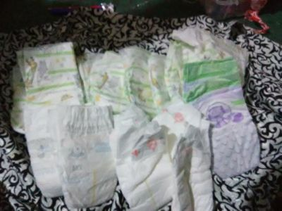 20 diapers (12 size one, 8 size two)