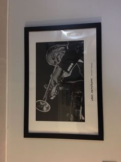 Louis Armstrong poster in frame